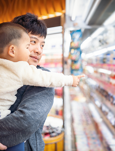 Taiwanese father and son shopping in a supermarket