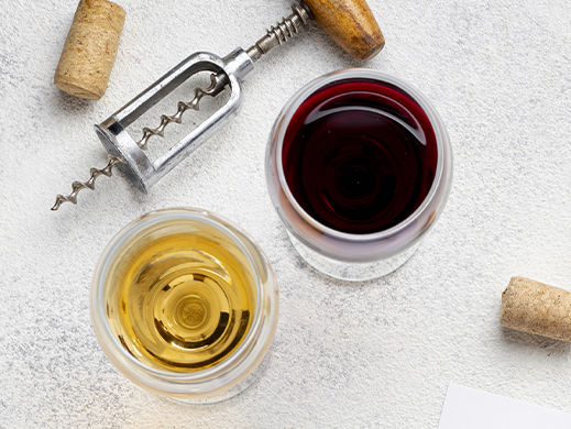 Top view of glasses of wine and vinegar