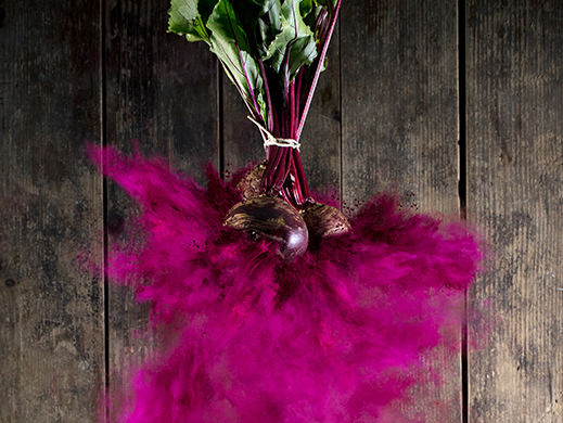 explosion of red beet turning into powder