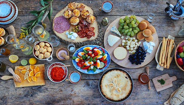 Top view of a wooden table full of various food