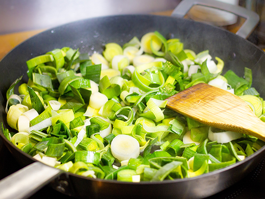 Culinary preparation with leek cooking in a pan