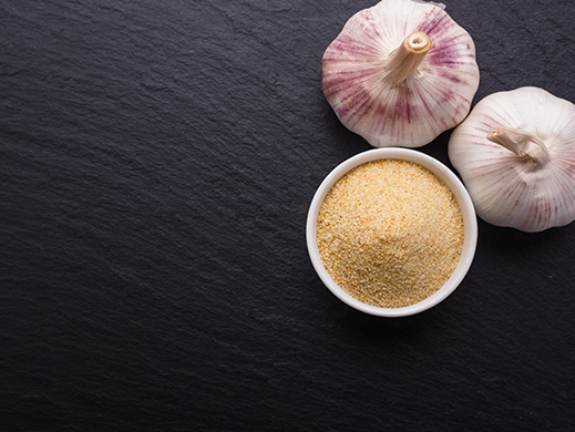 Top view of raw shallot with shallot powder