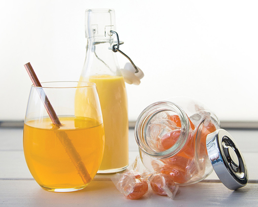 Yellow and oranges shades in beverages and sugar confectionary