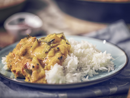Yellow curry sauce with rice in trendy plate
