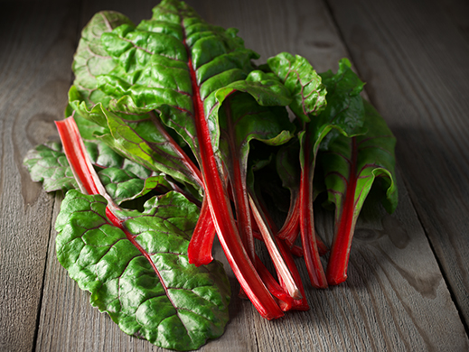 swiss chard on wooden table