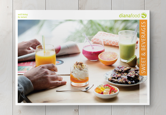 Top view of the Sweet and Beverages brochure on wooden table